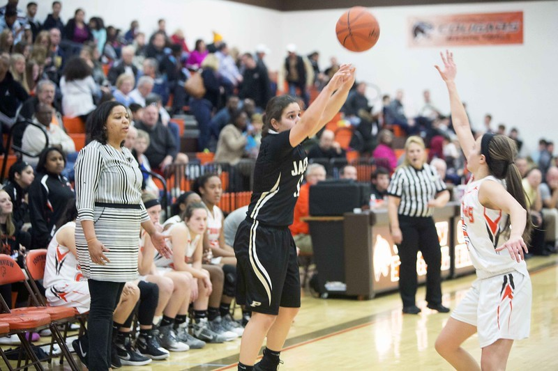 PHS student athlete shooting a basketball