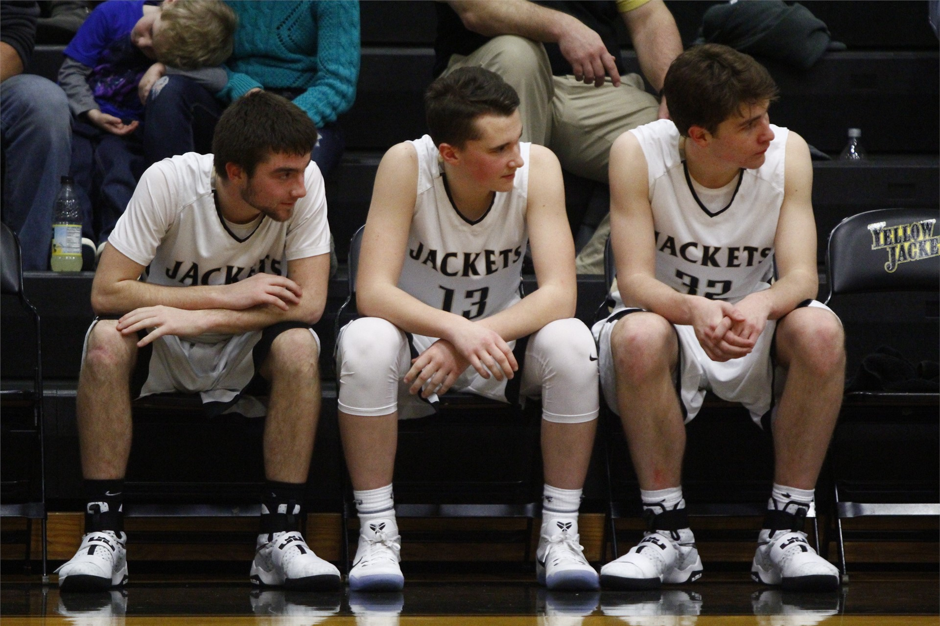 PHS basketball players sitting on the bench