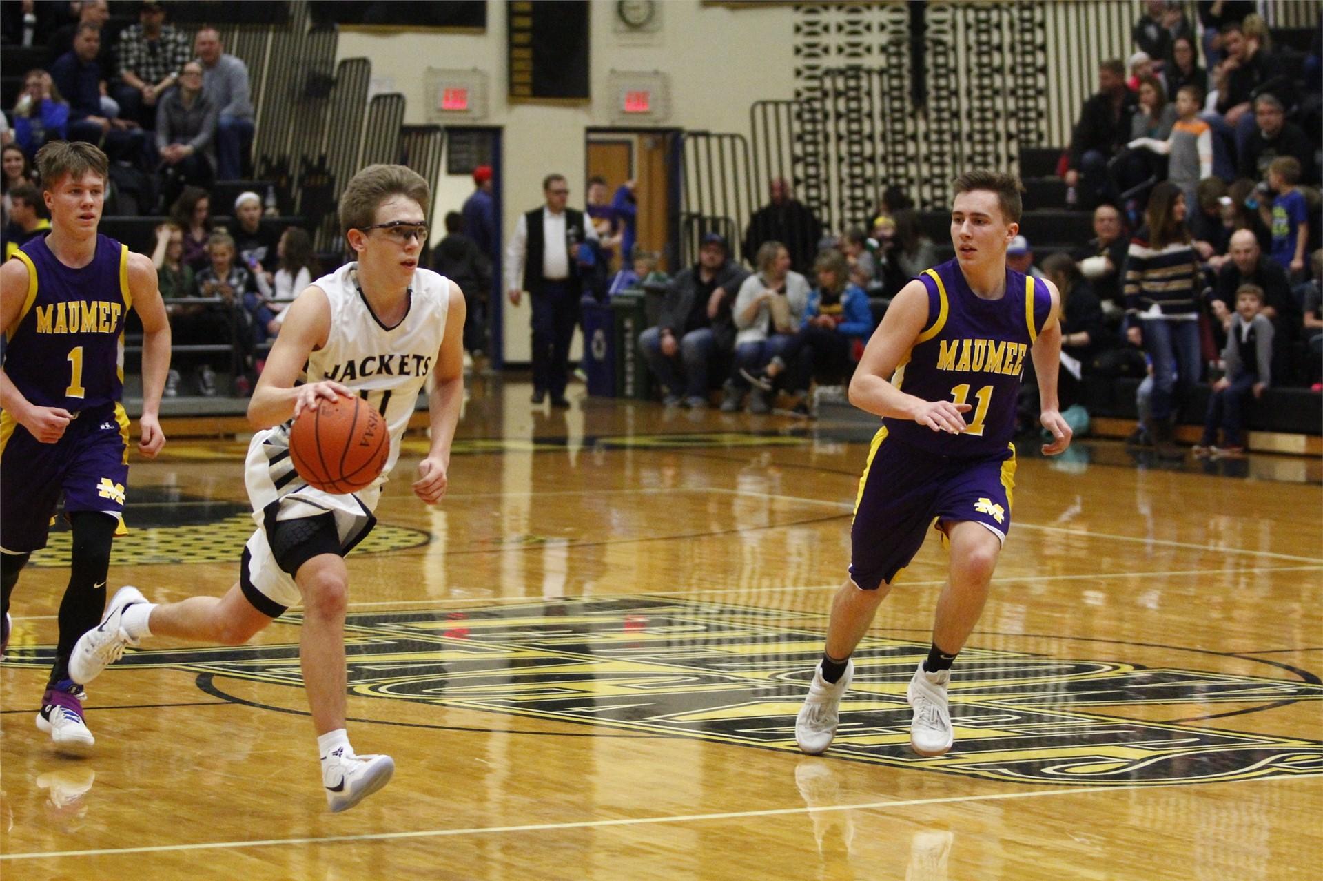 PHS student athlete dribbling a basketball