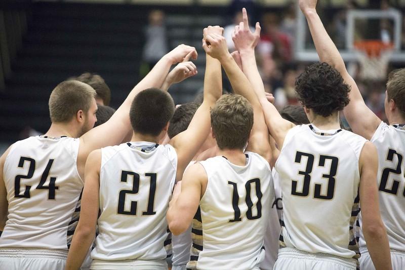 PHS basketball team doing a pregame cheer