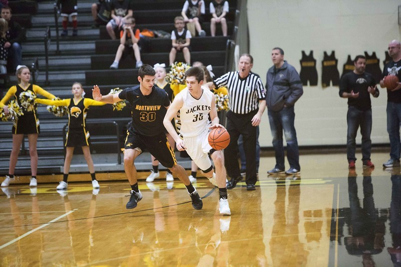 PHS student athlete dribbling a basketball