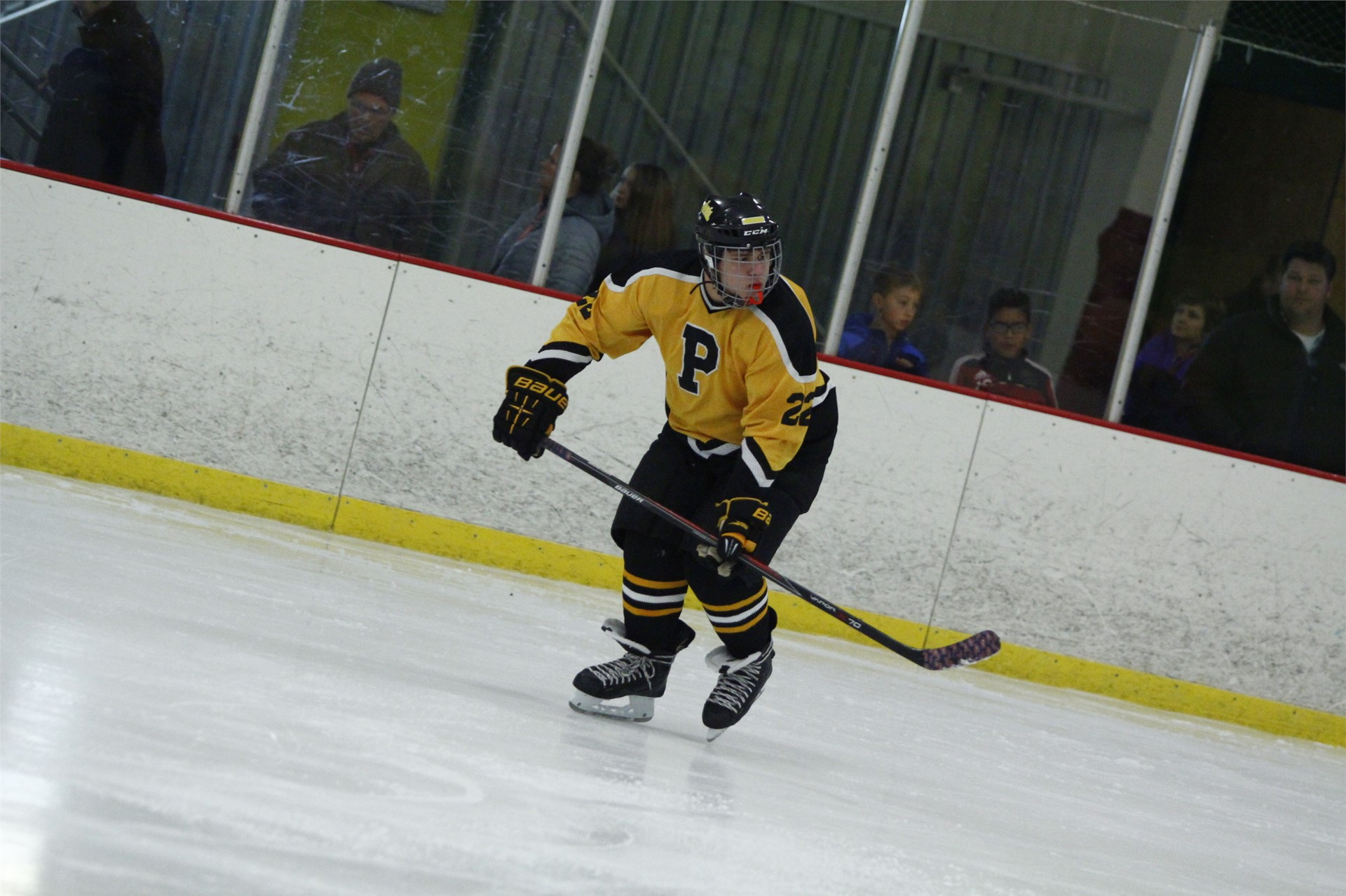 PHS student athlete skating down the ice