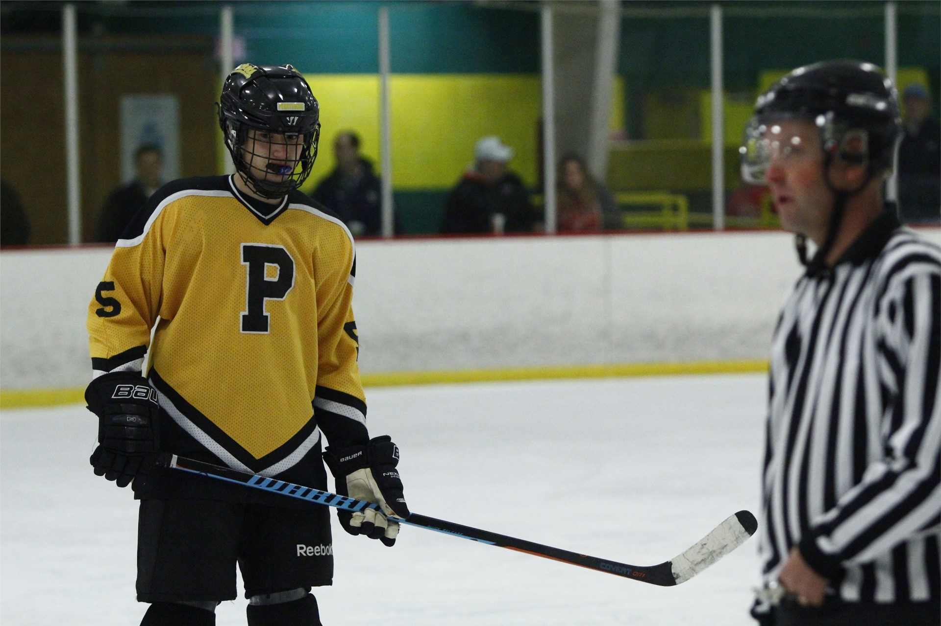PHS student athlete skating to the bench