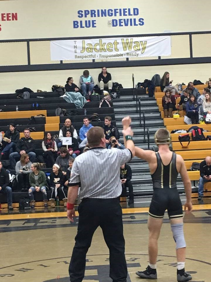 PHS student athlete winning a wrestling match