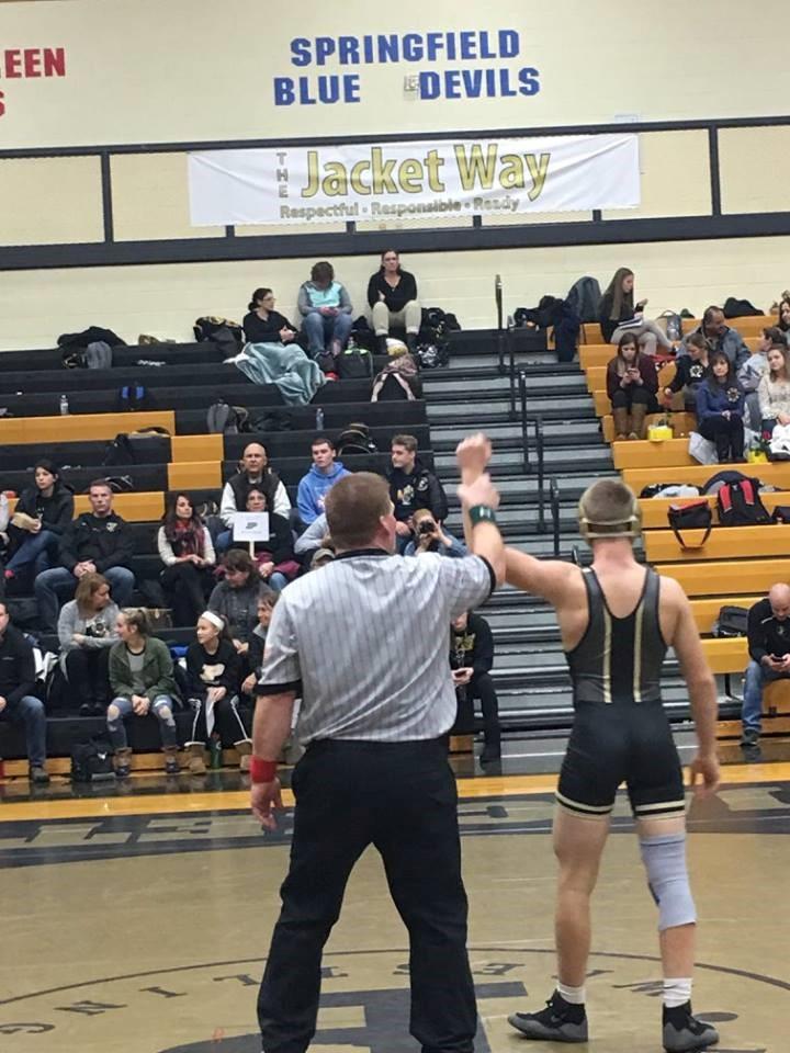 PHS student athlete winning a wrestling match