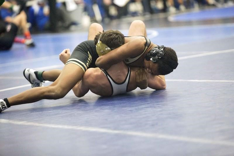 PHS student athlete wrestling at a meet