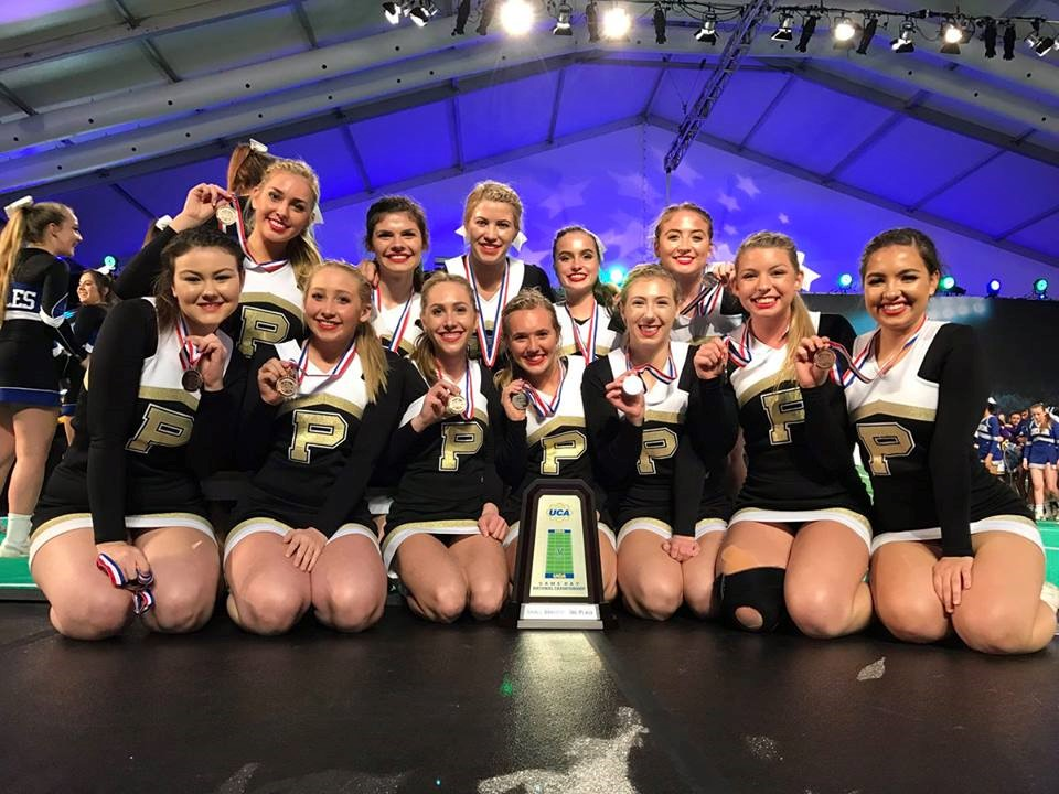PHS cheerleaders celebrating at a competition