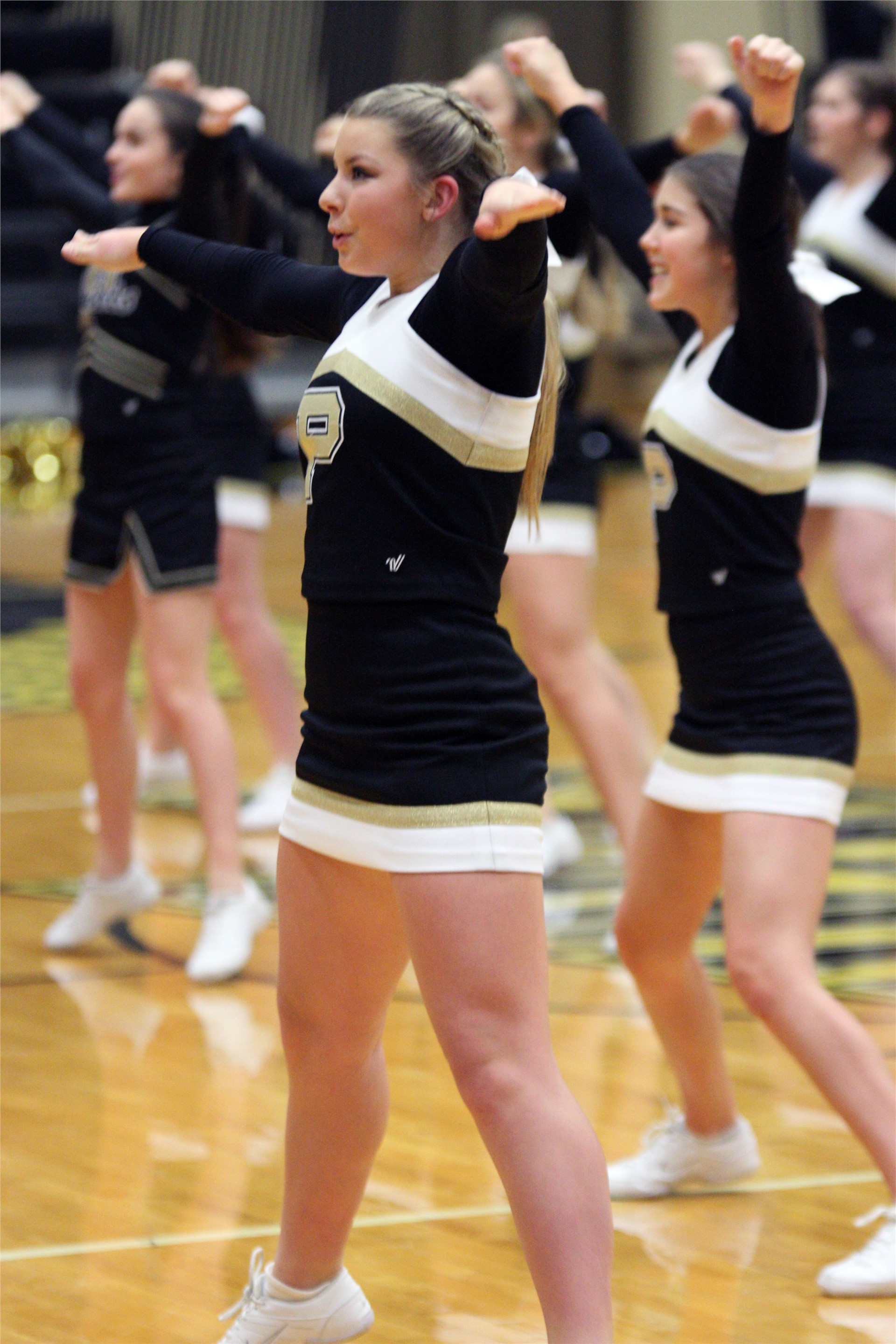 PHS cheerleader performing at a game