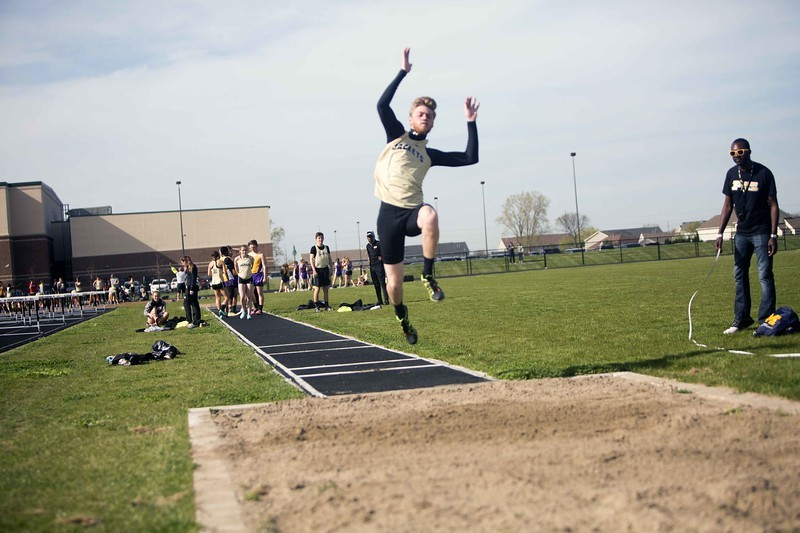 boy long jumping