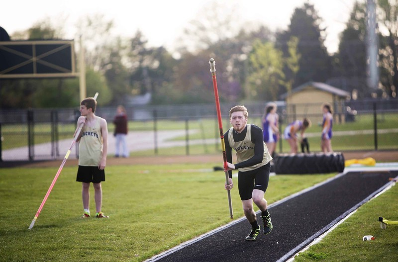 Boy pole vaulting