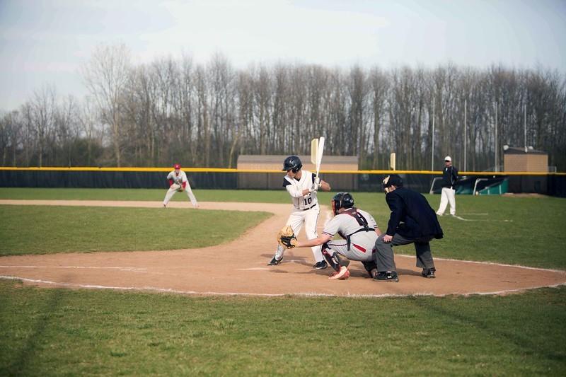 Student athlete hitting