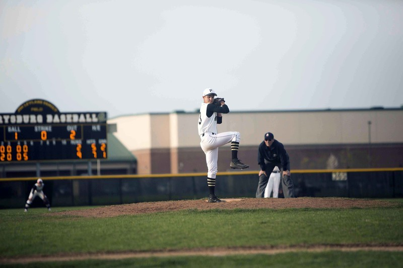 Student athlete pitching