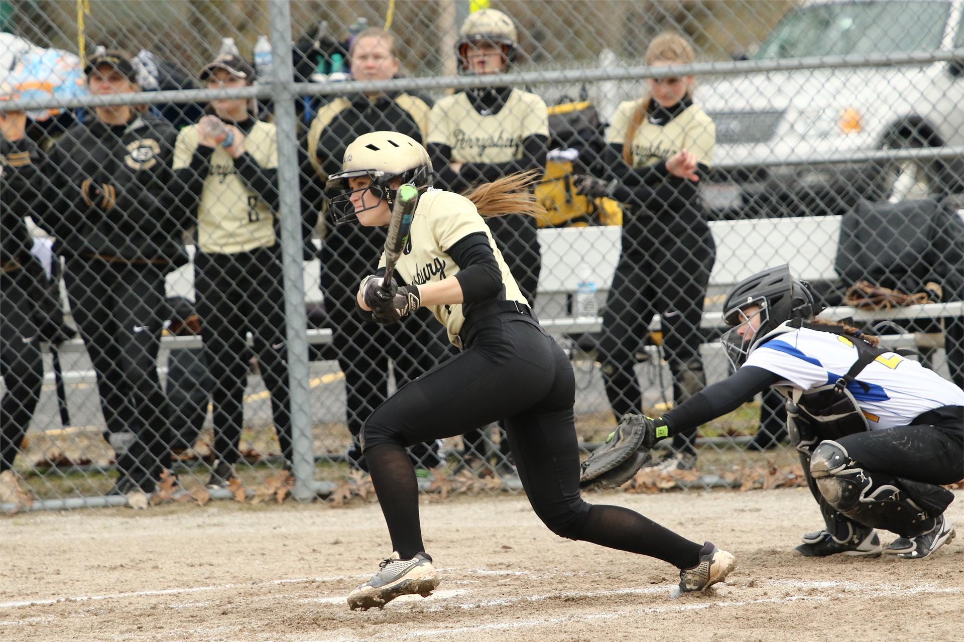 softball player hitting