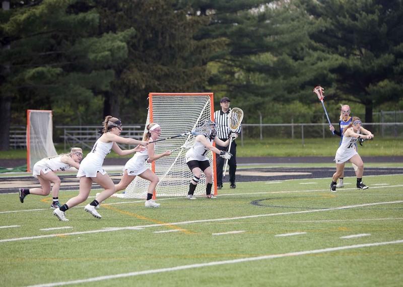 Lacrosse Player defending