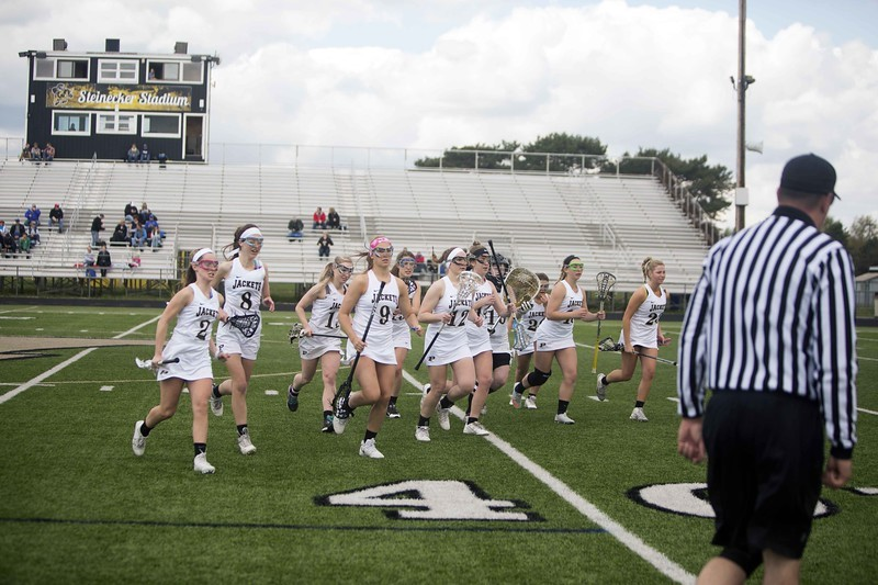 Lacrosse Players running off the field