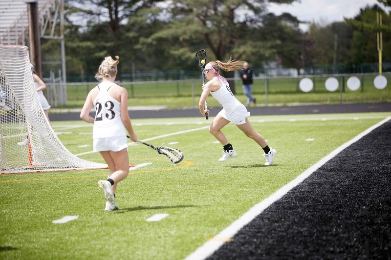 Lacrosse Player running