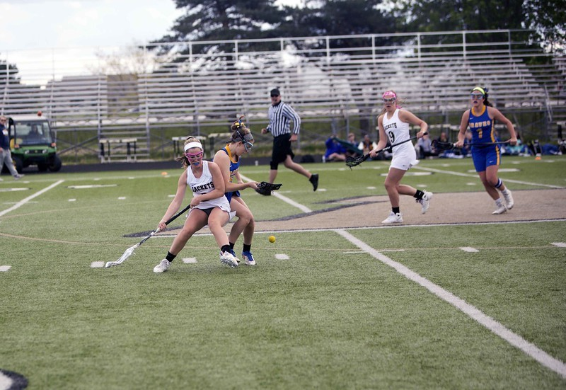 Lacrosse Player trying to get the ball