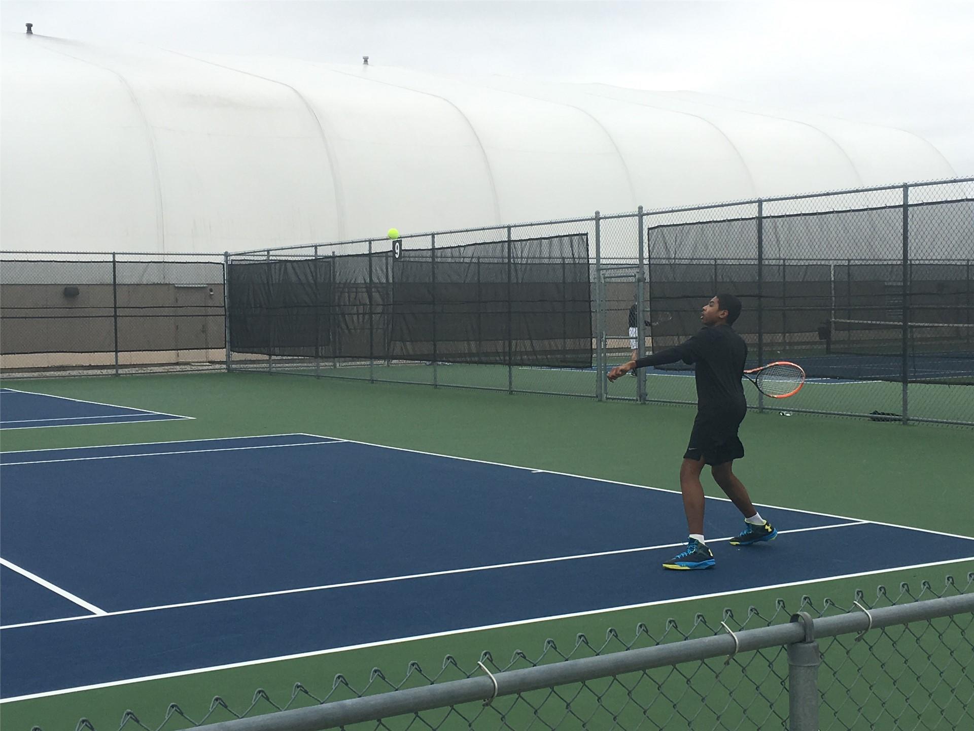 Tennis Player hitting