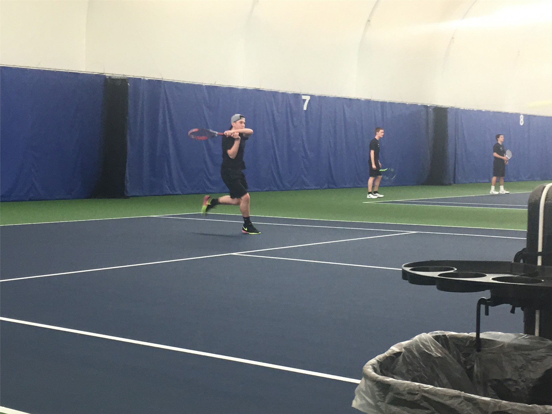 Tennis Player hitting