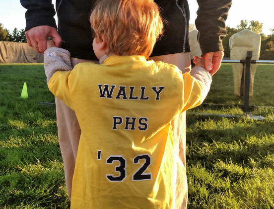 "Preschool student with shirt that says ""Wally PHS '32"""