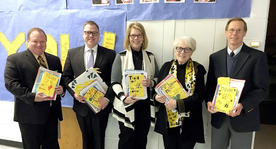 Perrysburg Board of Educations members smiling with packages of thank-you notes