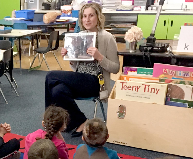 Principal Brook Price reads The Polar Express to Students