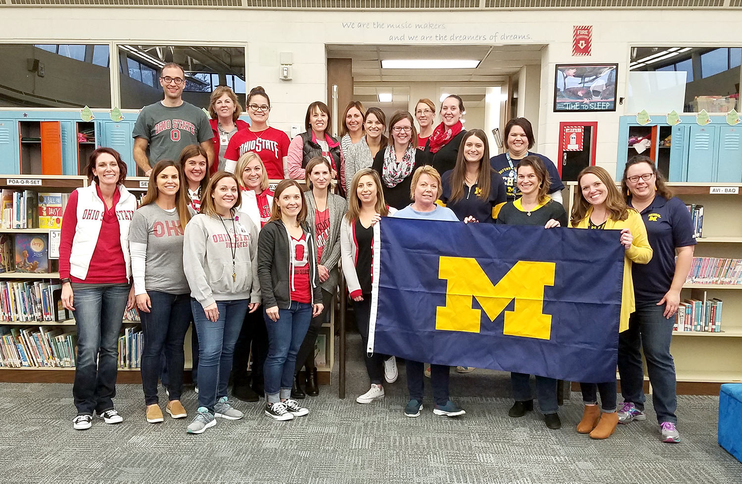 Woodland employees pose for photo in OSU and Michigan colors