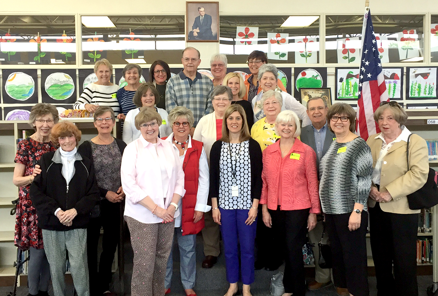 Retirees and Staff pose with Former Principal Larry Studer