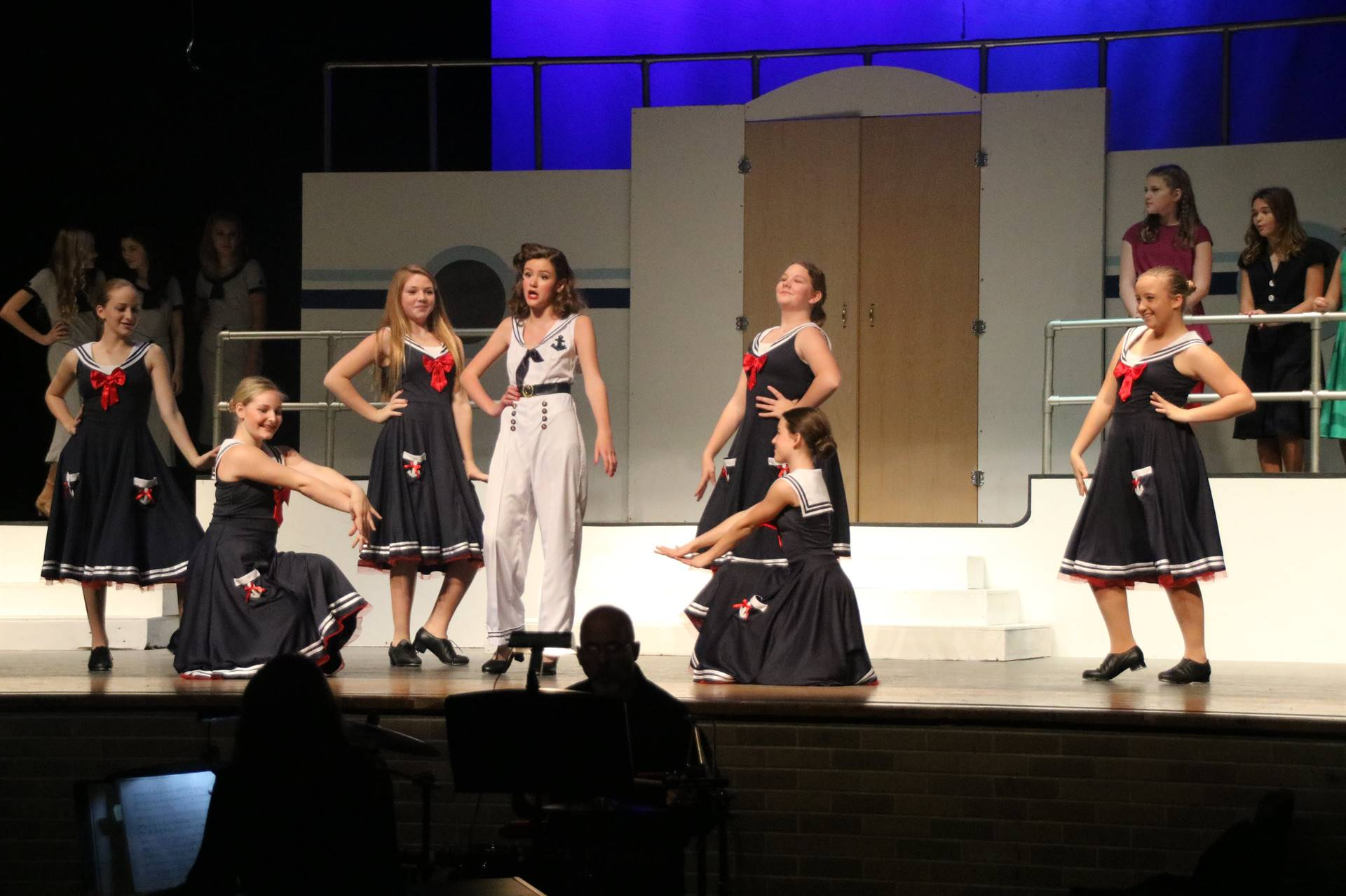 Students dancing on stage in costume - PJHS's fall musical, Anything Goes