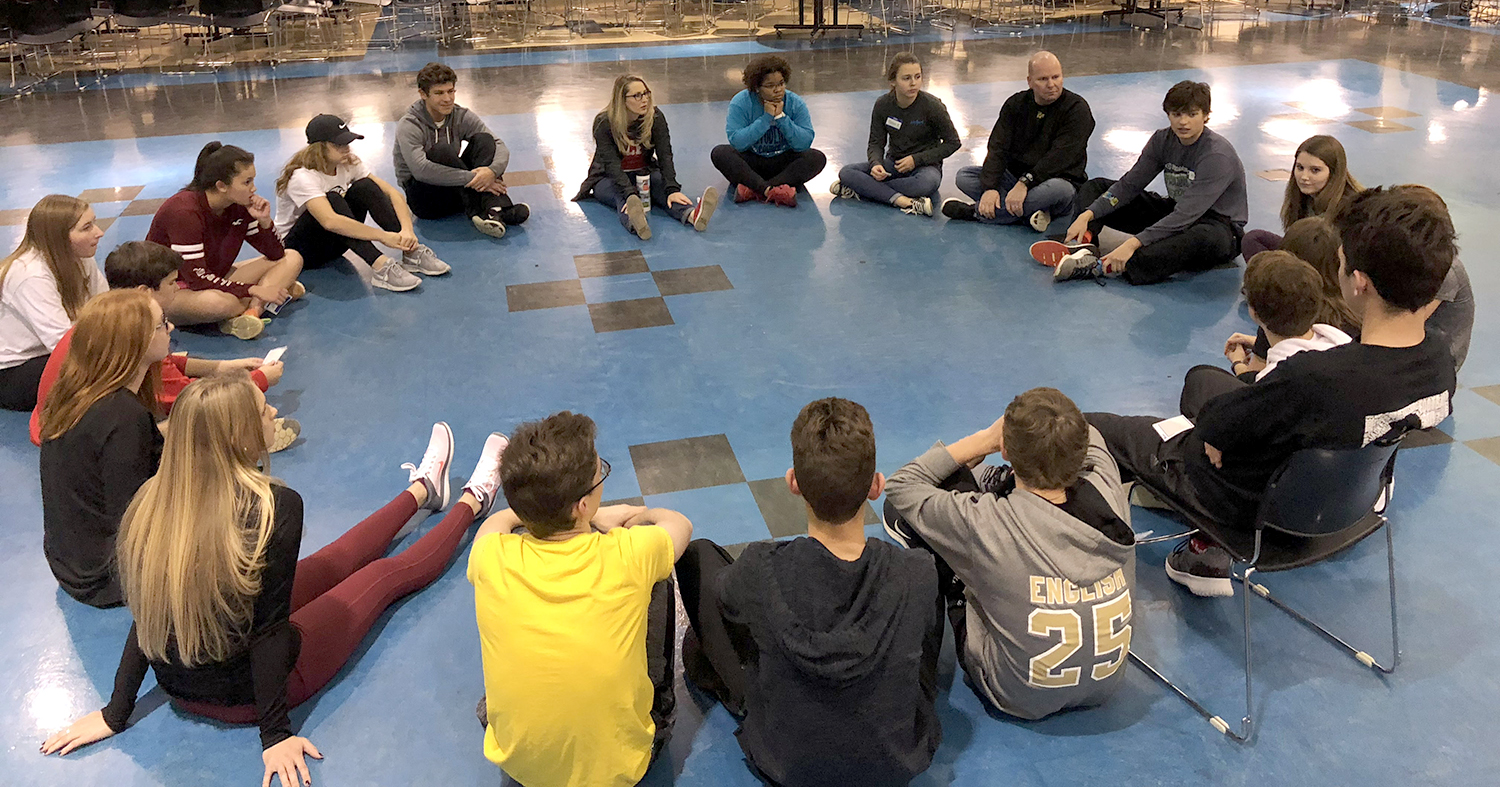 Members of Perrysburg High School Student Council sitting and talking in a circle