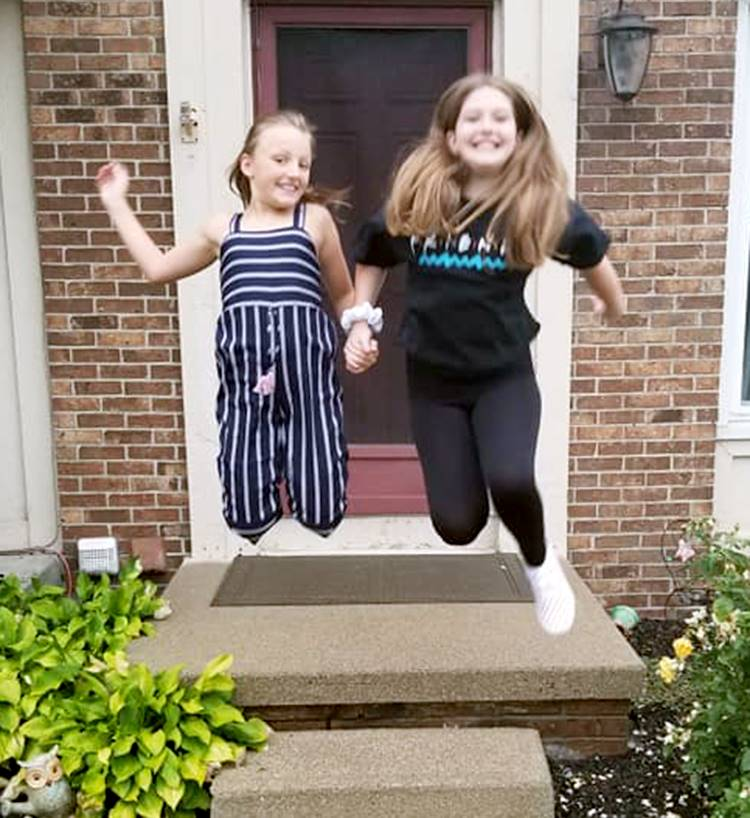 Sisters smiling before first day of school