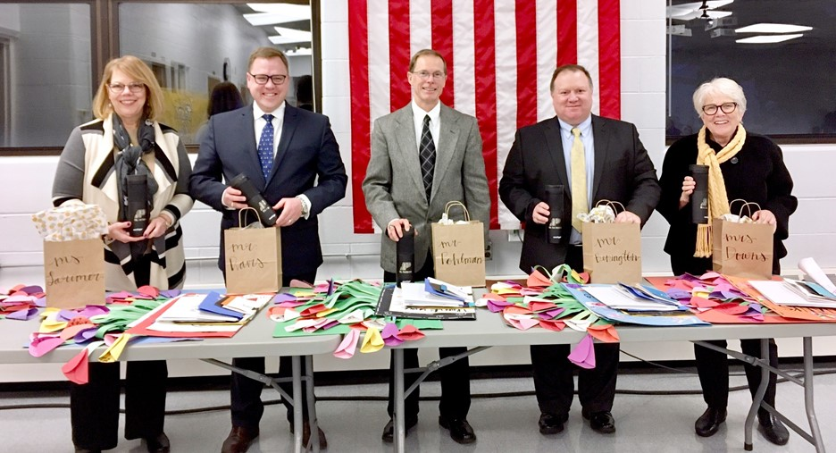 Perrysburg Board of Education members smiling with packages of thank-you notes