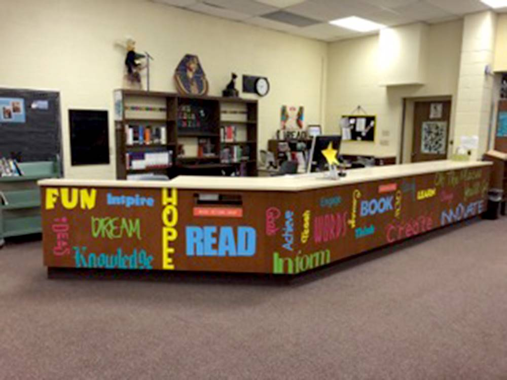 media center main desk with encouraging phrases written across it