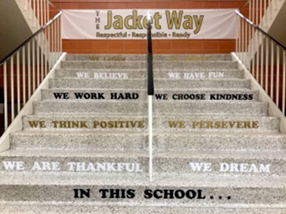 Steps at school with Jacket Way slogans on them