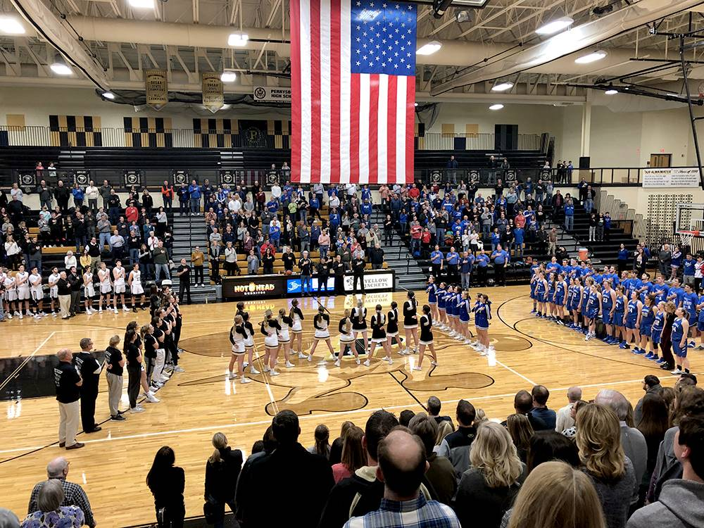 Military appreciate night at basketball game - entire gym standing and saluting the flag