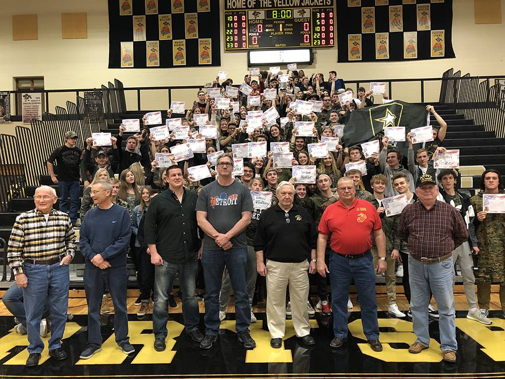 recognition of 7 veterans with a crowd of students