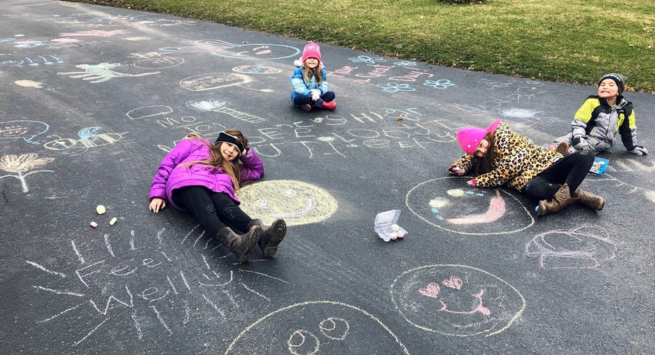 "four children making positive chalk drawings--Emojis and ""Feel Well!"""