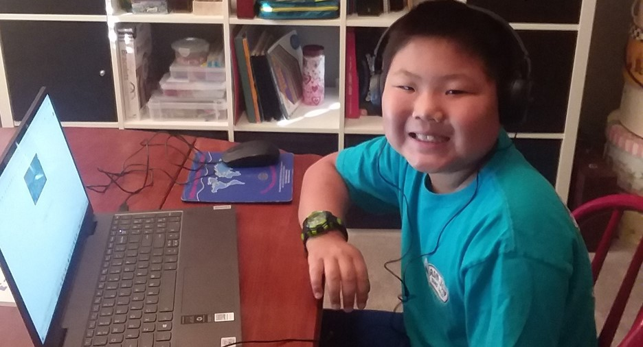 young student at a laptop at home