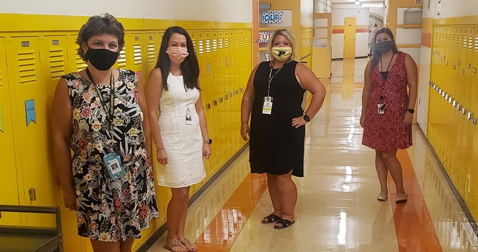 four teachers in hallway